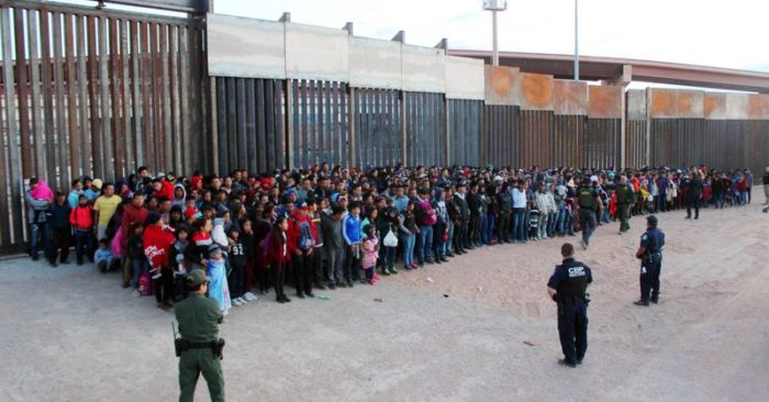 FILE - This May 29, 2019 file photo released by U.S. Customs and Border Protection (CBP) shows some of 1,036 migrants who crossed the U.S.-Mexico border in El Paso, Texas, the largest that the Border Patrol says it has ever encountered. (U.S. Customs and Border Protection via AP, File)