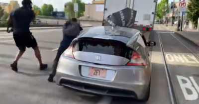 Portland: Car tries to escape crowd of anti-police protesters, drags one on hood