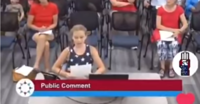 Despite the school's 'no politics' rule, a 9-year-old student chastises the school board for having BLM posters in school