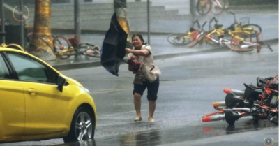 As Typhoon In-fa pounds down on China's east coast, flood victims want answers