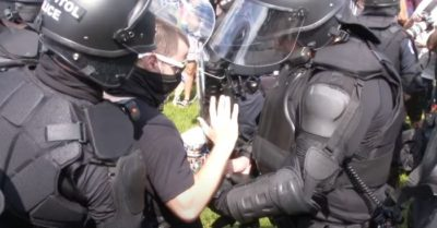 Capitol Police remove undercover cop from Justice for J6 rally